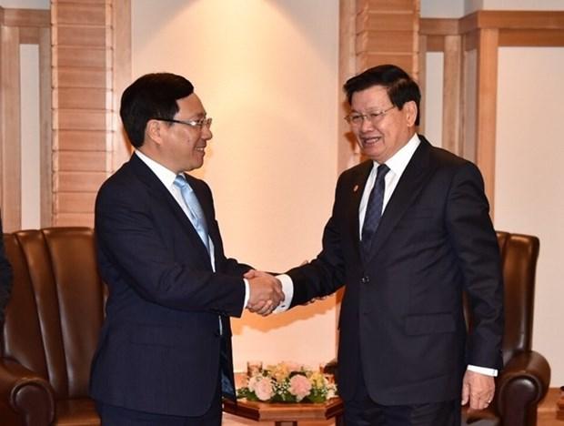 Le vice-PM Pham Binh Minh rencontre des dirigeants japonais et laotien a Tokyo hinh anh 2