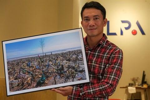 Il parcourt le pays pour photographier les sites pollues hinh anh 1