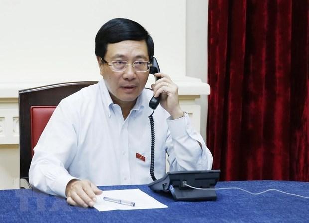 Conversation telephonique entre le vice-PM Pham Binh Minh et le chef de la diplomatie singapourienne hinh anh 1
