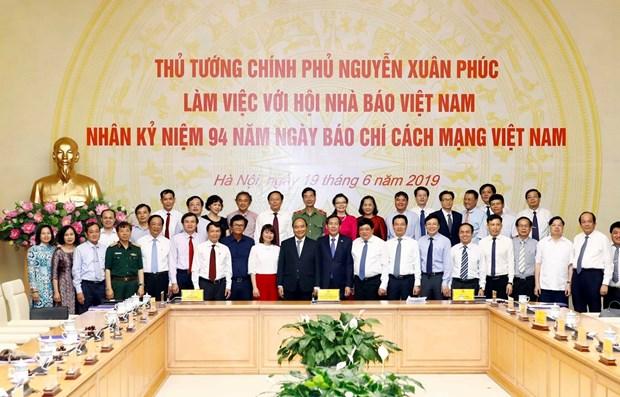 Le PM rencontre des journalistes a l'occasion de la Journee de la presse revolutionnaire hinh anh 1
