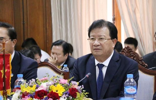 Vietnam et Laos continuent de promouvoir une cooperation multiforme hinh anh 1