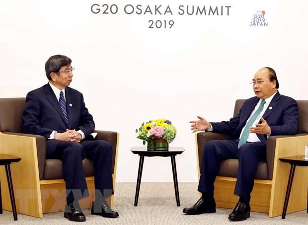 Sommet du G20 : le PM Nguyen Xuan Phuc rencontre des dirigeants etrangers hinh anh 3