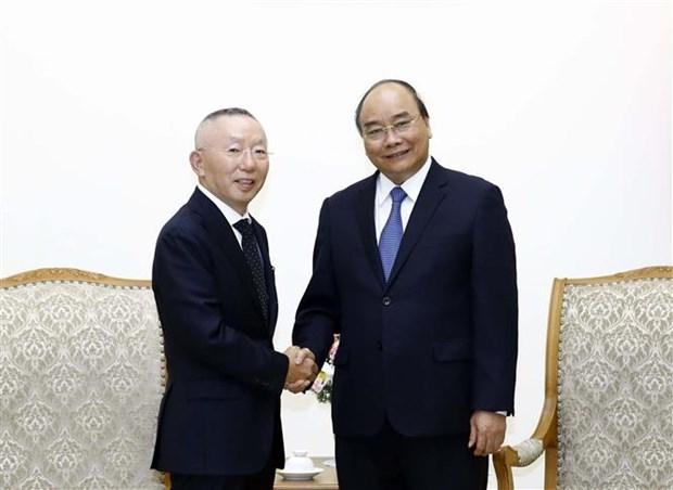 Le Premier ministre recoit le PDG du groupe japonais Fast Retailing hinh anh 1