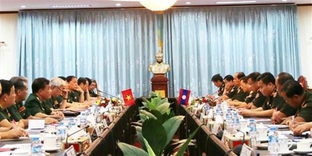Le Vietnam et le Laos echangent sur la politique de defense hinh anh 1