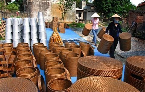 Hanoi, la terre ou convergent les elites des villages de metiers hinh anh 1