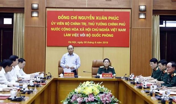 Le PM souligne l'edification economique et la defense nationale hinh anh 1