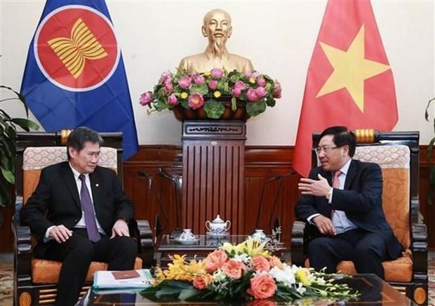 Le vice-PM et ministre vietnamien des AE recoit le secretaire general de l'ASEAN hinh anh 1