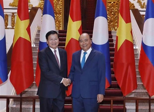 Entretien entre les Premiers ministres vietnamien et laotien hinh anh 1