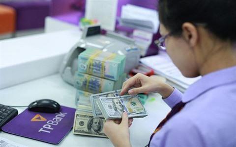 Le regime des credits en devises se durcit hinh anh 1