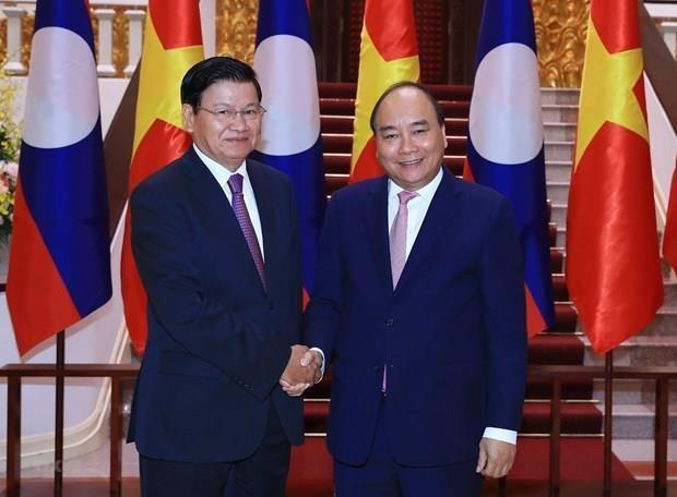 La visite du PM Thoungloun Sisoulith au Vietnam couverte par la presse laotienne hinh anh 1