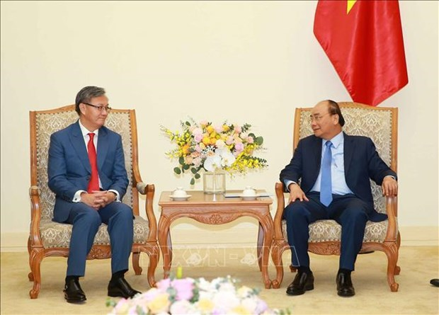 Le Premier ministre Nguyen Xuan Phuc recoit l'ambassadeur laotien hinh anh 1