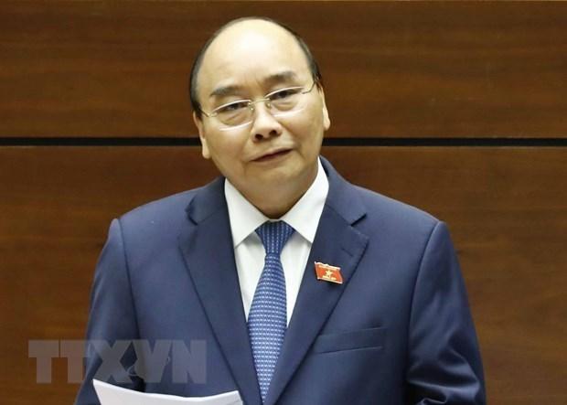 Le PM repond aux questions lors de la session de questions-reponses de l'AN hinh anh 1