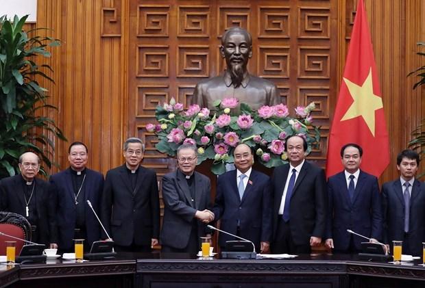 Le PM recoit des membres de la Conference des eveques du Vietnam hinh anh 1