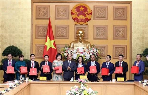 Le PM exhorte les jeunes entrepreneurs a redoubler d'efforts pour le developpement hinh anh 1