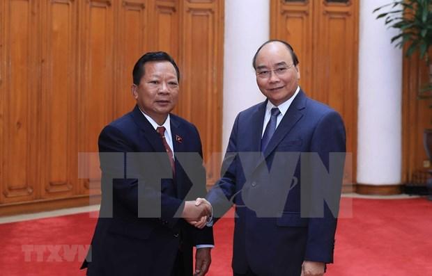 Le PM Nguyen Xuan Phuc recoit les ministres laotien et cambodgien de la Defense hinh anh 1