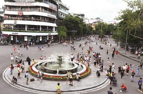 Ballade dans la zone pietonne de Hoan Kiem, espace culturel de Hanoi hinh anh 1