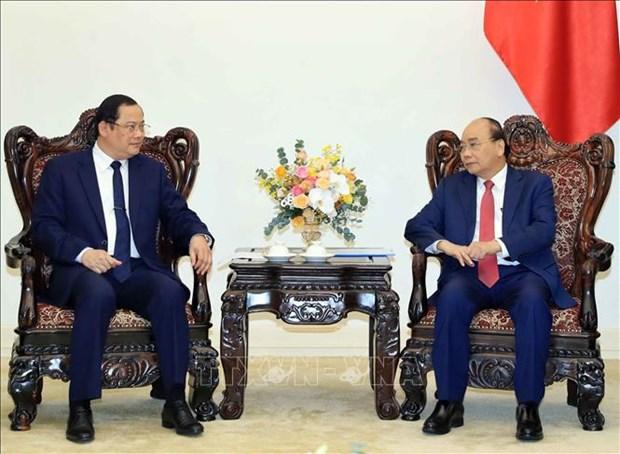Le PM Nguyen Xuan Phuc recoit le vice-PM et ministre laotien du Plan et de l'Investissement hinh anh 1
