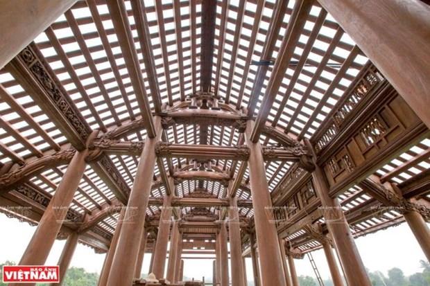 A Chang Son, le village qui perpetue l'habitat traditionnel en bois hinh anh 3
