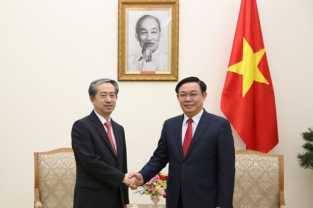 Le vice-PM Vuong Dinh Hue recoit l'ambassadeur de Chine hinh anh 1