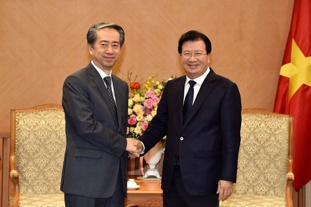 Le vice-PM Trinh Dinh Dung recoit l'ambassadeur de Chine hinh anh 1