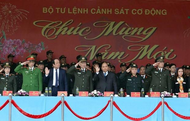 Le PM inspecte l'etat de preparation au combat de la police mobile hinh anh 1