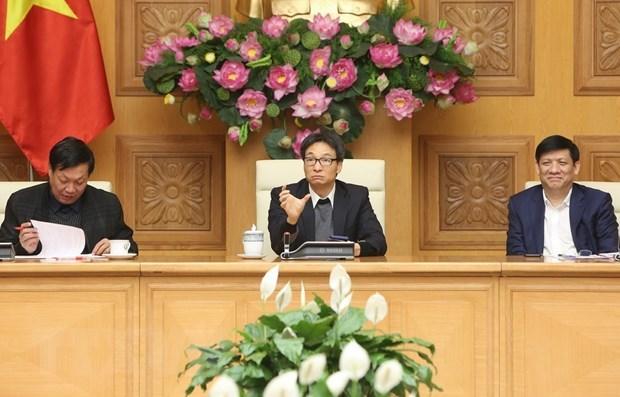 Le vice-PM Vu Duc Dam preside une reunion sur les mesures face au nCoV hinh anh 1