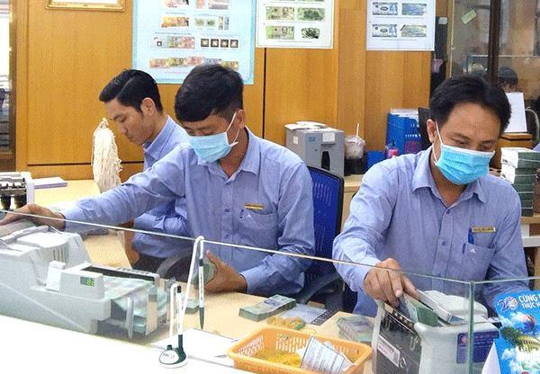 La Banque d'Etat renforce la prevention et le controle de l'epidemie de COVID-19 hinh anh 1