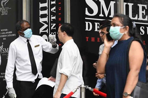 Singapour prend des mesures supplementaires face au COVID-19 hinh anh 1