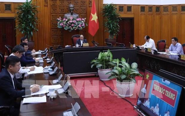 Le PM discute des mesures contre l'intrusion saline avec Soc Trang hinh anh 1