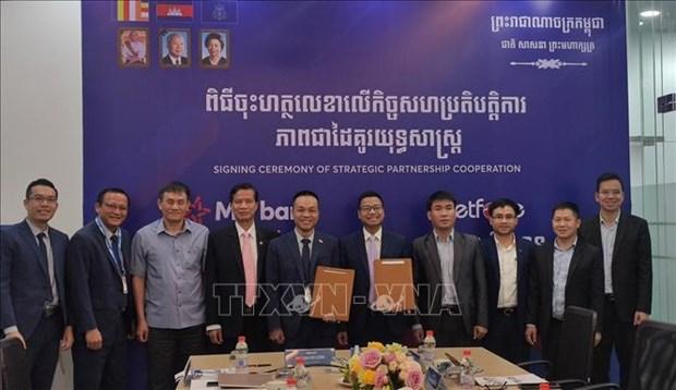 Cooperation strategique entre Metfone et la succursale de la MB au Cambodge hinh anh 1
