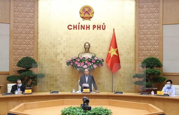 Le Premier ministre exhorte la collaboration a s'intensifier dans la lutte contre le COVID-19 hinh anh 1