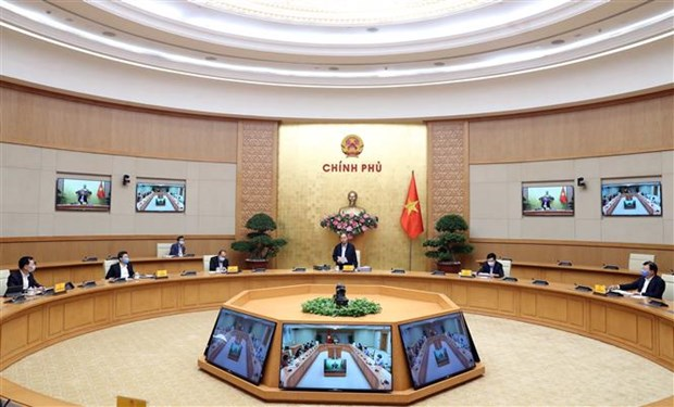 Le PM preside une seance de travail sur la lutte contre l'epidemie de coronavirus hinh anh 1