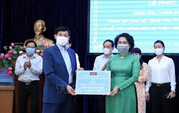 Les Vietnamiens residant a l'etranger soutiennent la lutte anti-coronavirus hinh anh 1