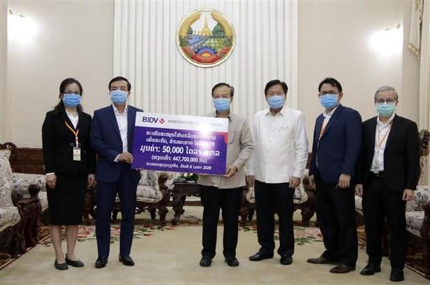 Coronavirus: des entreprises vietnamiennes viennent en aide au Laos hinh anh 2
