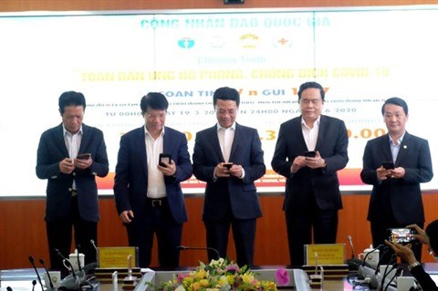Coronavirus : les dons via SMS atteignent 5,4 millions de dollars hinh anh 1