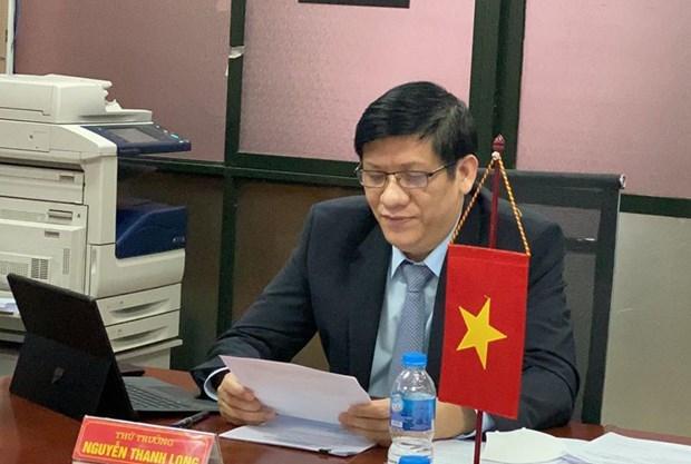 Sante : des responsables vietnamiens et laotiens discutent de la lutte contre le COVID-19 hinh anh 1