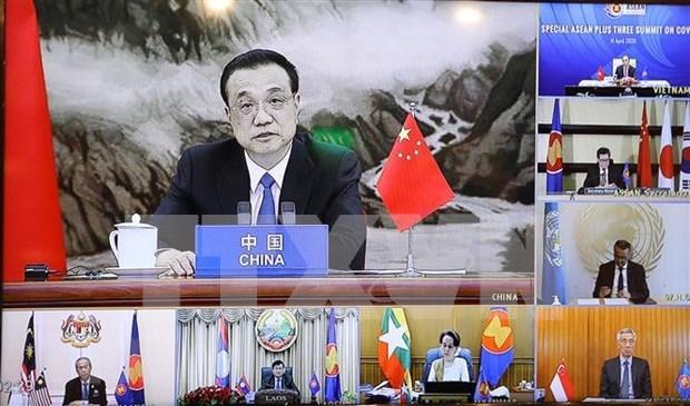 Le Premier ministre chinois appelle a des efforts conjoints contre le COVID-19 hinh anh 1