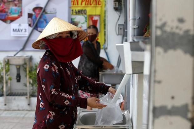 Les medias internationaux louent les ATM de riz gratuits au Vietnam hinh anh 1