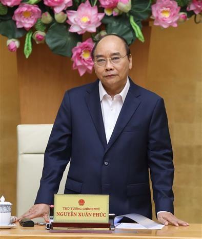 Le PM Nguyen Xuan Phuc demande a Hanoi de relancer son economie hinh anh 1