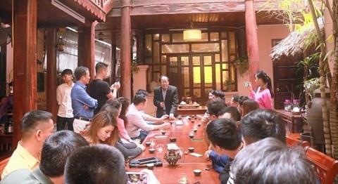 Visite d'une maison de the traditionnel au cœur de Hanoi hinh anh 4