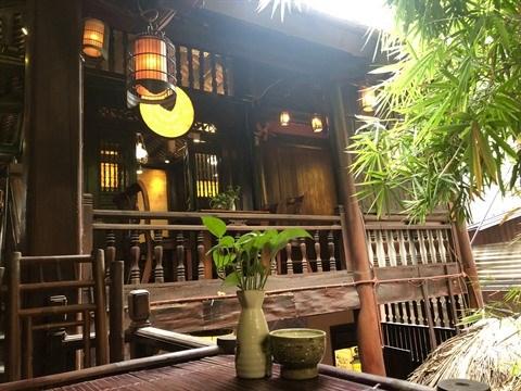 Visite d'une maison de the traditionnel au cœur de Hanoi hinh anh 1