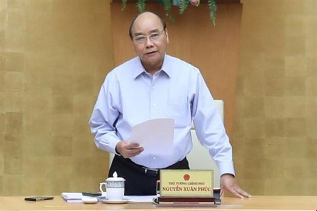 Le PM preside une reunion sur la lutte contre le nouveau coronavirus hinh anh 1