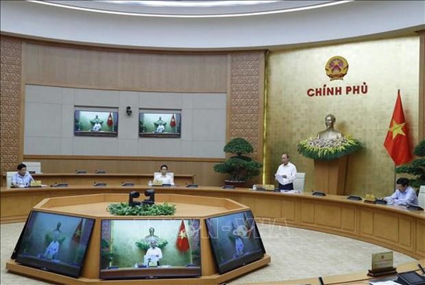 Le PM souligne le retablissement et le developpement des activites socio-economiques hinh anh 1