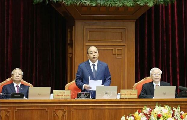 Le 12e Plenum du CC du Parti acheve sa 1re journee de travail hinh anh 1