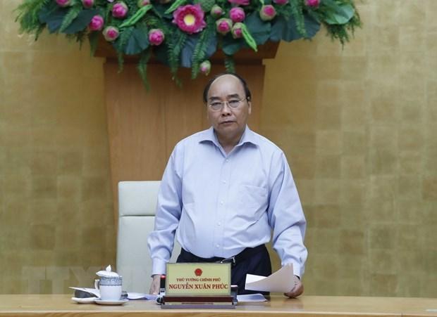 Coronavirus : le PM demande de poursuivre les efforts pour realiser le double objectif hinh anh 1