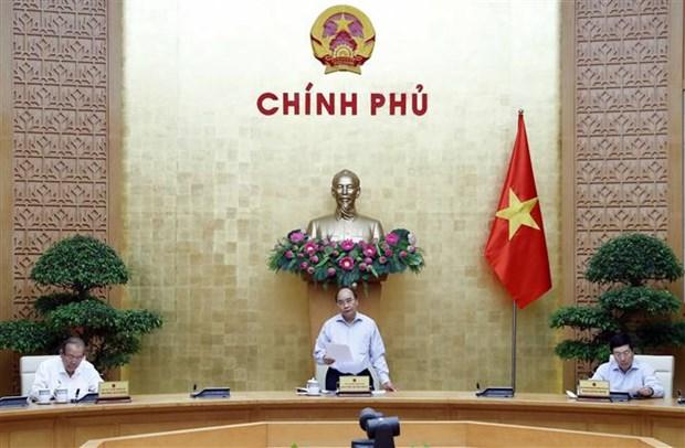 Le PM preside une reunion de la permanence du gouvernement sur le COVID-19 hinh anh 1
