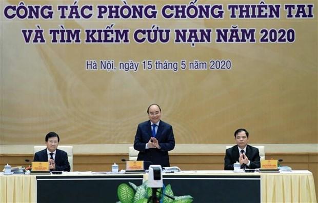 Le PM preside une conference nationale sur la lutte contre les catastrophes naturelles hinh anh 1