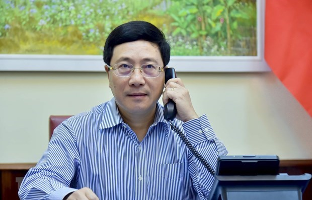 Le Vietnam et le Japon discutent de la lutte contre COVID-19 et de la cooperation economique hinh anh 1