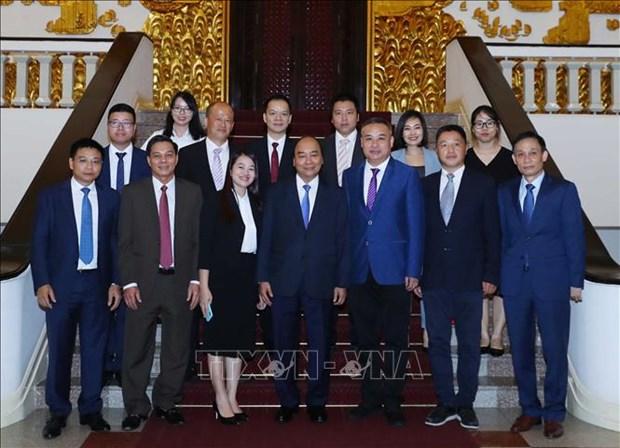 Le PM rencontre une delegation d'entrepreneurs chinois investissant au Vietnam hinh anh 1