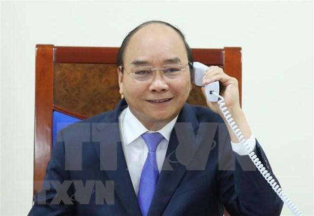 Les PM vietnamien et malaisien s'entretiennent par telephone hinh anh 1
